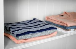 Stack of clothes. On shelves Stock Photo
