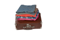 Stack of clothes on suitcase isolated on white background Royalty Free Stock Photography