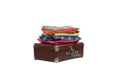 Stack of clothes on suitcase isolated on white background Stock Images