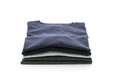 Stack of clothes on white. Background Stock Photo