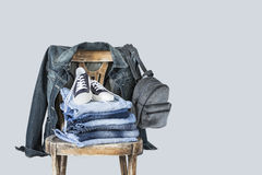 Stack of clothes on wooden chair. Stack of clothes on  wooden chair Royalty Free Stock Photo