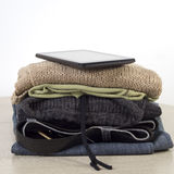 Stack of clothes on a Wooden table Stock Photos