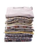 Stack of clothing. Shirt, isolated on white Royalty Free Stock Image