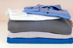 Stack of clothing isolated on white Stock Photos