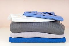Stack of clothing isolated on white Royalty Free Stock Images
