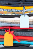 Stack of clothing with labels royalty free stock photo