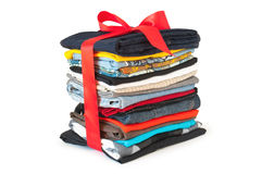 Stack of clothing with red ribbon stock photography