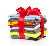Stack of clothing with red ribbon Stock Photos
