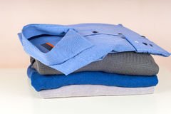 Stack of clothing  on white Stock Photo