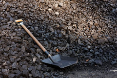 Stack of coal. A shovel in the heap of coal Stock Images