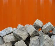 Stack of cobble stone on orange Royalty Free Stock Photography