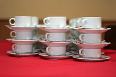 Stack of coffee cups at banquet royalty free stock image