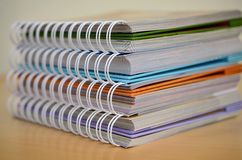 Stack of coil bound books Stock Photos