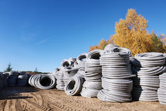 Stack of coiled plastic pvc Polyethylene Corrugated drainage pipes for sewer system outdoor warehouse Stock Photography