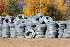 Stack of coiled plastic pvc Polyethylene Corrugated drainage pipes for sewer system outdoor warehouse Royalty Free Stock Photos