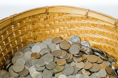Stack of coin with bamboo bucket Royalty Free Stock Image