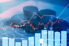 Stack coin money with book bank report finance with profit graph. Of stock market trade indicator financial.Double exposure style Stock Photos
