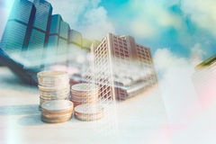 Stack coin money with city background. Concept in grow for success in business and finance banking. Double exposure style Royalty Free Stock Photography