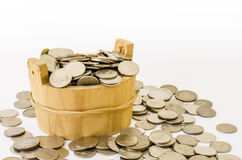Stack of coin with wood bucket stock photos