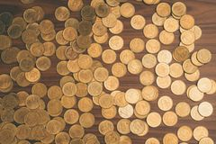 Stack of coin on wooden working table, business and finance conc Stock Images
