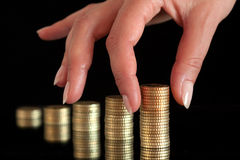 Stack of coins. Coins get stapeld to several towers Royalty Free Stock Photo