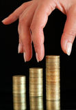 Stack of coins. Coins get stapeld to several towers Stock Photo