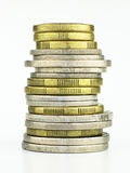 A stack of coins. Against a white background Royalty Free Stock Images