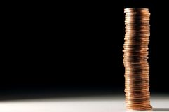 Stack of coins. Long stack of golden coins Royalty Free Stock Images