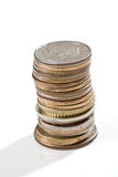 Stack of coins. Isolated on white background stock images