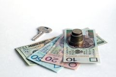 Stack of coins with banknotes and pens and key. Stack of coins with banknotes and pens. finance, money, business, white chess, king, queen. World money with stock photography