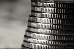 Stack of coins black and white macro Stock Photos
