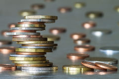 Stack of coins with blurred grey background Stock Photography