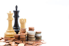 Stack coins and chess. Income and profits. Marketing strategy. Stack coins and chess. Business finance Stock Images