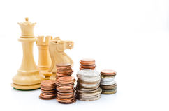 Stack coins and chess. Income and profits. Marketing strategy. Stack coins and chess. Business finance Royalty Free Stock Photography