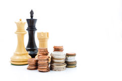Stack coins and chess. Income and profits. Marketing strategy. Stack coins and chess. Business finance Stock Photos