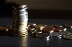 Stack of Coins on Dark Background stock photo