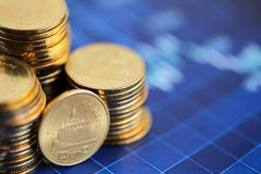 Stack of coins with Finance  graph background. Stack of coins with Finance  graph background Royalty Free Stock Photo