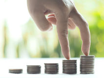 Stack coins , Financial concept. Stack coins on green bogey stock photo