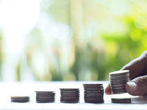 Stack coins , Financial concept. Stack coins on green bogey royalty free stock photography