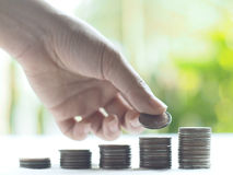 Stack coins , Financial concept. Stack coins on green bogey stock photography