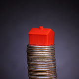 Stack of coins and home. Mortgage - home icon on a stack of coins Royalty Free Stock Photos