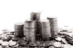 Stack of coins isolated on a white Royalty Free Stock Photo