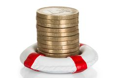 Stack of coins with lifebelt Stock Images