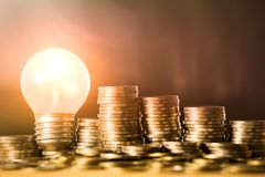 Stack of coins and light bulb for saving money concept, Creative ideas of business planning, success in the future stock photos