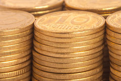 Stack of coins. Stack of many gold coins, ten ukrainian kopeck Royalty Free Stock Photography