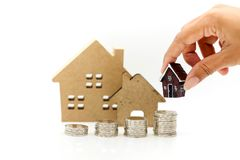 Stack of coins with mini house,Business finance, saving and home. Loan mortgage concept royalty free stock photo