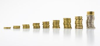 Stack of coins, nine of rows isolated on white background with clipping path without a shadow. Growing and saving money concept. stock photography