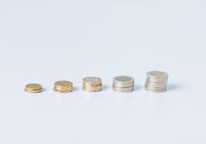 Stack of coins in one row Royalty Free Stock Image