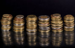 Stack Coins Over Black Background Stock Photos