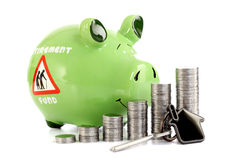 Stack of coins with piggy bank and house shape key Stock Images